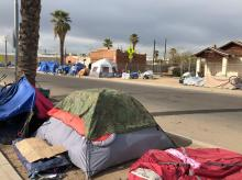 Homeless tents lined up along a downtown Phoenix street
